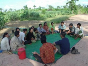 Bernie meeting with farmers in rural village in Cambodia